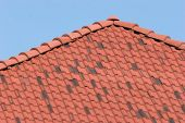picture of hacienda  - a hacienda style clay shingle roof against a blue sky  - JPG
