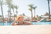 Beautiful Young Woman Relaxing In Spa Swimming Pool. poster