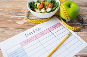 healthy eating, dieting, slimming and weigh loss concept - close up of diet plan paper with green ap poster