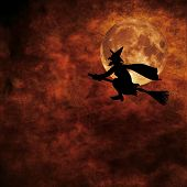 stock photo of minx  - grunge background with silhouette of witch flying on a broom on full moon halloween night - JPG