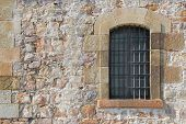 Wall with window of fort Montjuic in Barcelona poster