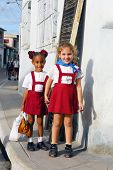 CAMAGUEY,CUBA- CIRCA NOVEMBER 2008: Unidentified schoolgirls in red school uniform in the city of Ca