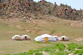 stock photo of scant  - Mongolian jurts camping at the mountain foot - JPG