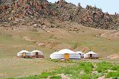 image of scant  - Mongolian jurts camping at the mountain foot - JPG