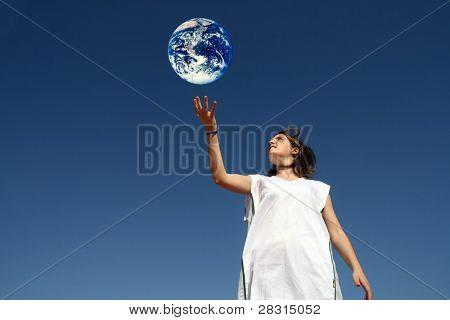girl holding earth (enviromental protection)