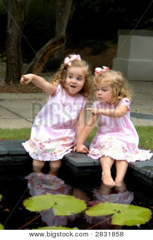 Beautiful Children Wading In Pool