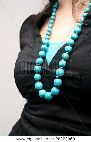 beautiful blue neckless over grey background