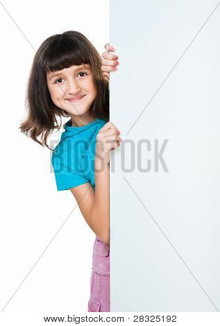 cute child behind a board over white background