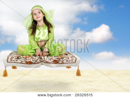 Little Arabian Girl Sitting On Flying Carpet