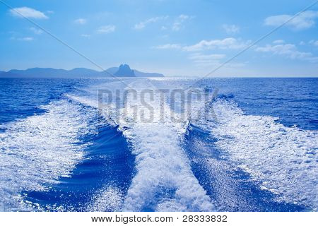 Es Vedra islet and Vedranell islands with boat wake in mediterranean Spain