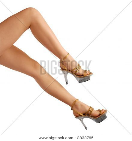 Well-Proportioned  Female Legs In Sandals