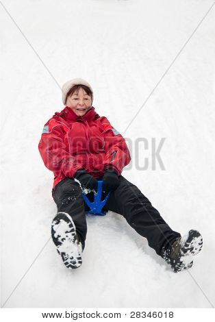 Senior Woman On Sledge - Winter Snow Activity