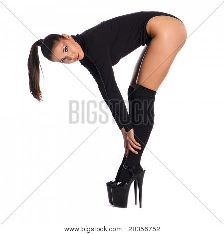 Young slim glamour lady with long hairs dressed in black combi dress