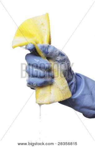 Man holding a soapy wet yellow cleaning cloth in his hand.