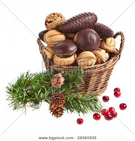 basket full christmas cookie with fir branch on a white background
