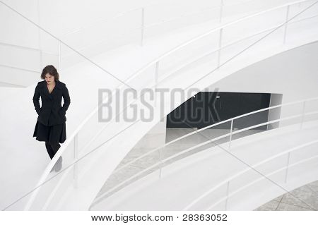 Young business woman walking in modern building