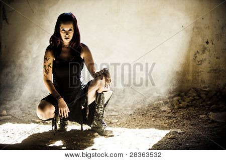 Beautiful woman posing in gothic clothes