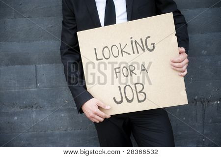 "Hands holding ""looking for a job"" sign"