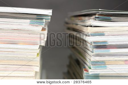 stacks of magazines on gray background