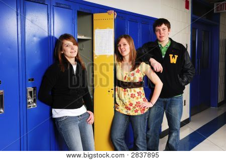 Teenage Students At School Lockers