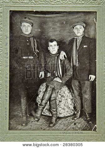 RUSSIA - CIRCA 1931: Old photo printed in Russia shows three young men from Siberia, circa 1931