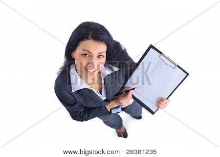 To view of smiling business woman writing in clipboard
