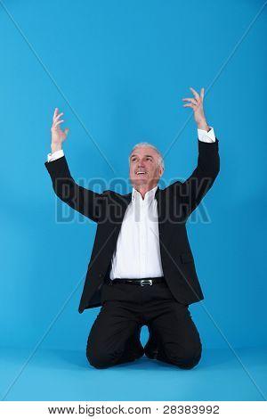 Businessman on his knees