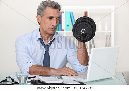businessman making exercises in his office