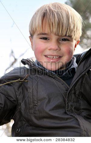 Portrait of a happy little boy outdoors