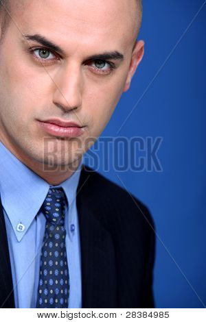 Bald young businessman