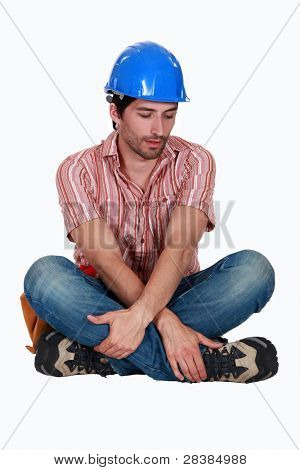 Tired looking construction worker