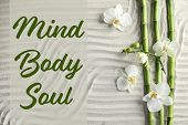 Flat Lay Composition Of Bamboo Stems With Orchid Flowers And Text Mind, Body, Soul On Sand. Zen Gard poster