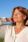 stock photo of early 50s  - Attractive Redhead Woman in the Early Morning Sun - JPG