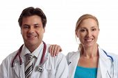 stock photo of rn  - Medical healthcare professionals in uniform stand casually together with relaxed friendly smiles - JPG