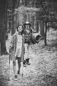 Young Couple With Happy Faces Walks. Tourists Concept. Man With Woman Hiking With Overnight Stay Or  poster