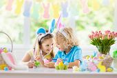 Kids On Easter Egg Hunt. Children Dye Eggs. poster