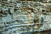 Picturesque Background Of Collapsing Surface Of Limestone Rock. Abstract Beautiful Forms Of Weatheri poster