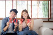 Beautiful Portrait Young Asian Couple Sitting On Sofa Holding Word Love Together In Living Room, Fam poster