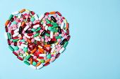 Heart Made Of Pills On Color Background, Top View With Space For Text. Cardiology Concept poster