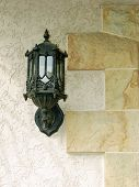 picture of front door  - Lantern on a stone background on stone background - JPG