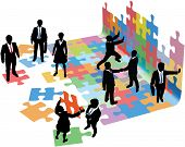 stock photo of collaboration  - Business people collaborate to put pieces together find solution to puzzle and build startup - JPG