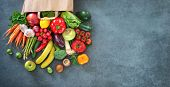 Healthy food selection. Shopping bag full of fresh vegetables and fruits. Flat lay food on table poster