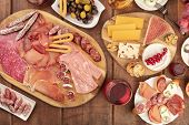 Charcuterie Tasting. A Photo Of Many Different Sausages And Hams, Deli Meats, And A Cheese Platter,  poster