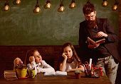 Boring Lesson Concept. Man With Beard Teaches Schoolgirls, Reading Book. Bored And Tired Children Li poster