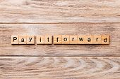 Pay It Forward Word Written On Wood Block. Pay It Forward Text On Wooden Table For Your Desing, Conc poster
