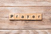 Prayer Word Written On Wood Block. Prayer Text On Wooden Table For Your Desing, Concept poster