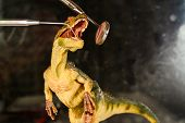 Dinosaur Velociraptor Examine Teeth With Dental Mirror And Probe. The Concept Of Dental Care. Toy Di poster