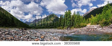 The Confluence Of Two Mountain Rivers