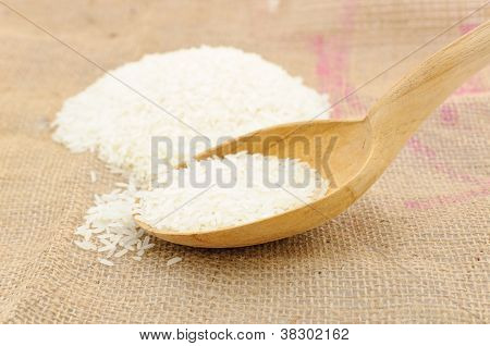 Wooden Spoon With Raw Rice