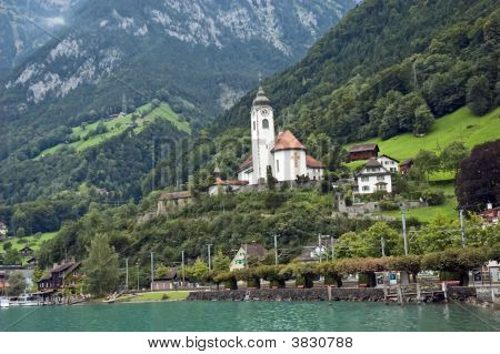 Alpine Church In Mountains Landscape